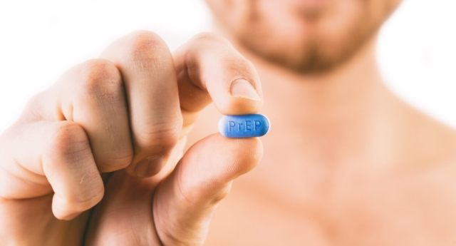 PrEP Impact trial: Man holding a pill used for Pre-Exposure Prophylaxis (PrEP) to prevent HIV infection (Stock photo)