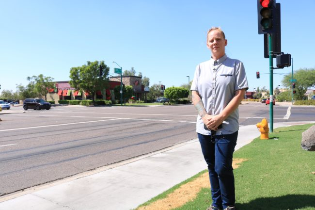 An ACLU picture of Meagan Hunter standing on the pavement across from Chili's