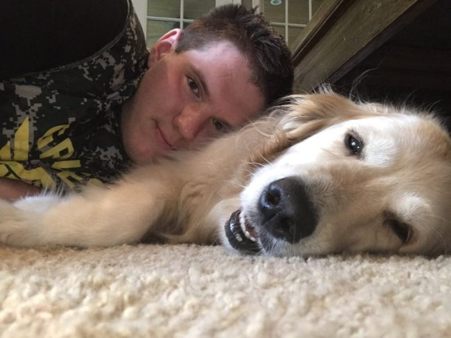 Christian Zeitvogel poses for a photo with his dog which he posted on Twitter