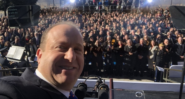 Jared Polis took a selfie from the inauguration stage to mark the historic moment. (Jared Polis/Twitter)