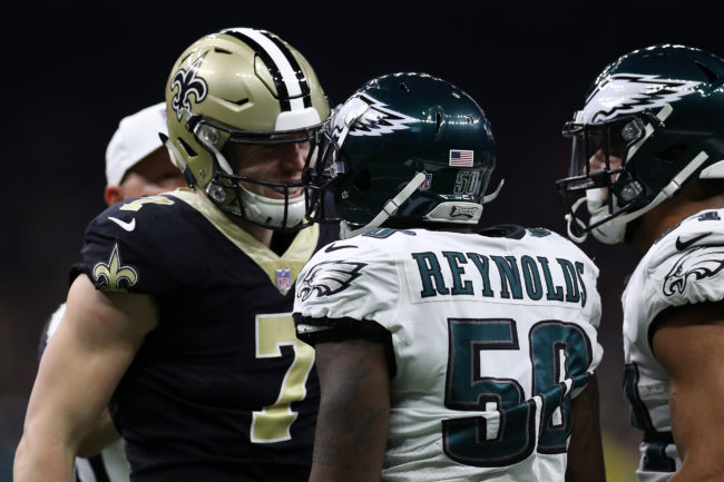 Taysom Hill of the New Orleans Saints argues with LaRoy Reynolds of the Philadelphia Eagles during the NFC Divisional Playoff