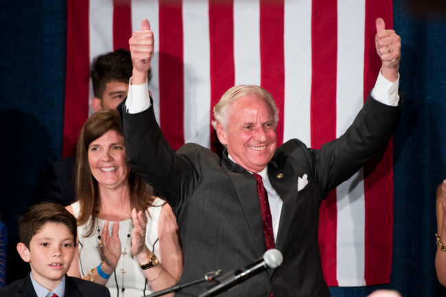South Carolina Governor Henry McMaster gives the crowd two thumbs up during a gubernatorial primary runoff election watch party at Spirit Communications Park on June 26, 2018 in Columbia, South Carolina