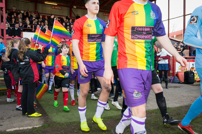 Altrincham FC players wearing an LGBT inspired kit to tackle homophobia in football