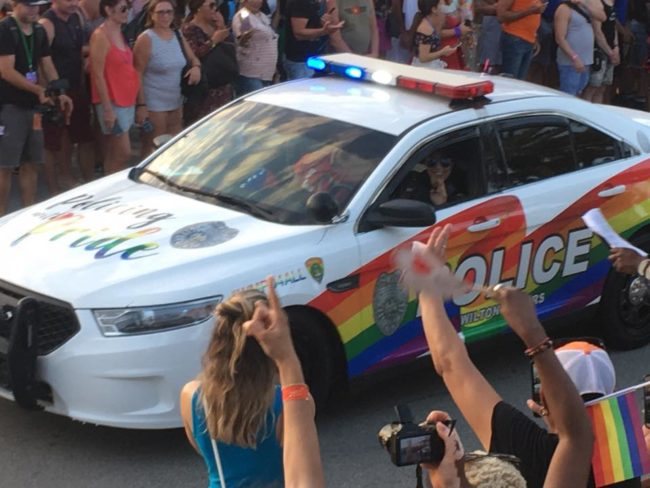 A police car takes part in Fort Lauderdale Gay Pride, where two people were stabbed on Sunday.
