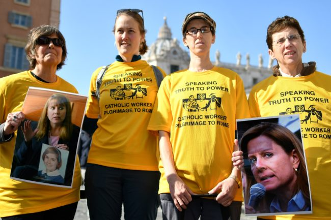 Members of Ending Clergy Abuse (ECA), a global organization of prominent survivors and activists who are in Rome for this weeks papal summit, display photos of Barbara Blaine, the late founder and president of Survivors Network of those Abused by Priests (SNAP), during an action on February 21, 2019 in Rome.