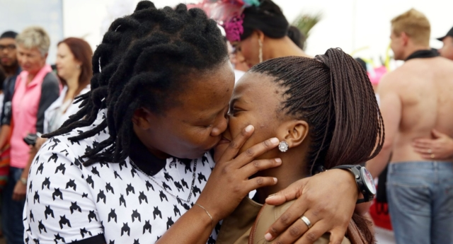 Two women kissing. (RAJESH JANTILAL/AFP/Getty Images)