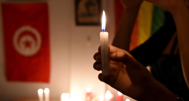 Tunisians belonging to the Tunisian association for justice and equality light candles and on June 14, 2016 in Tunis. (Fethi Belaid/AFP/Getty Images)