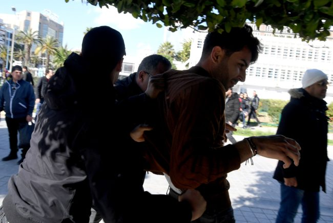 Tunisian policement pbreak off a protest by LGBT+ activists, who have protested the sentencing of a victimof rape and robbery for homosexuality.