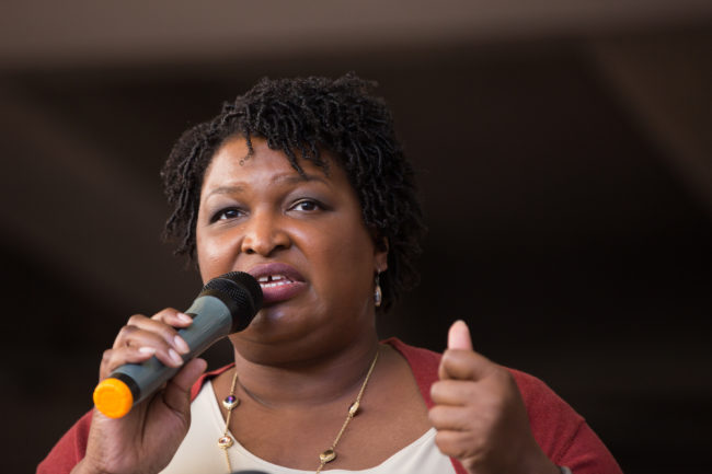 """Democratic Georgia Gubernatorial candidate Stacey Abrams talks to a crowd gathered for the """"Souls to The Polls"""" march in downtown Atlanta on October 28, 2018 in Atlanta, Georgia."""