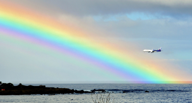 File photo. A plane is seen next to a rainbow (MARTIN BERNETTI/AFP/Getty)