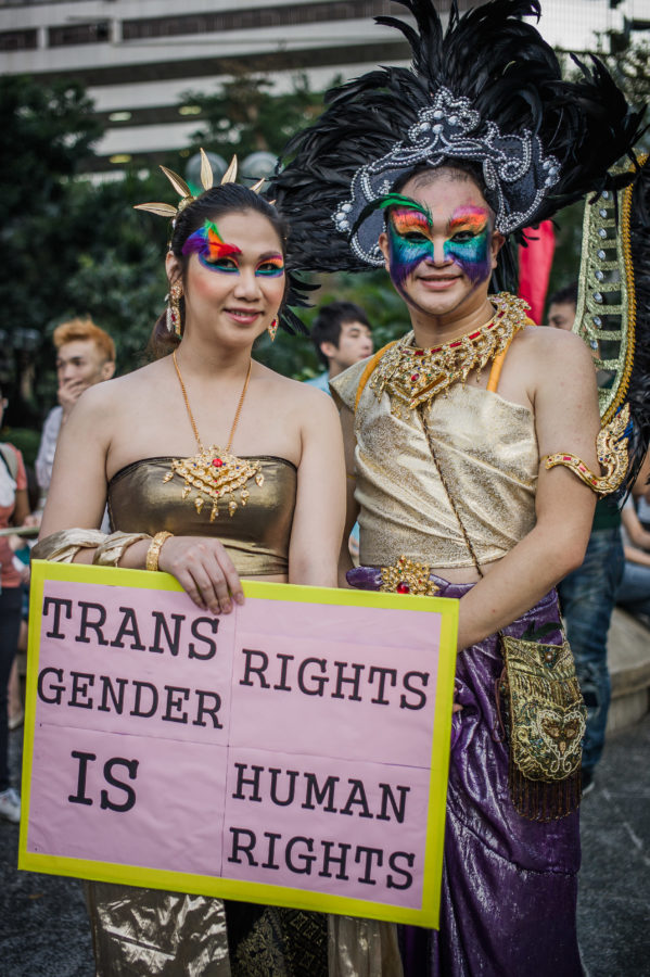 Participants display a placard during a Gay Pride parade in Hong Kong on November 10, 2012 with lesbian, gay, bisexual and transgender people