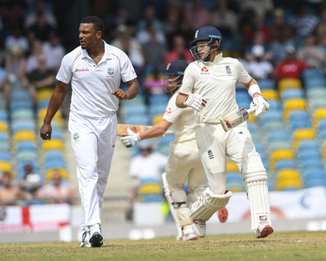 Joe Root (R) of England get runs off Shannon Gabriel (L) of West Indies during day 4 of the 1st Test between West Indies and England at Kensington Oval, Bridgetown, Barbados, on January 26, 2019