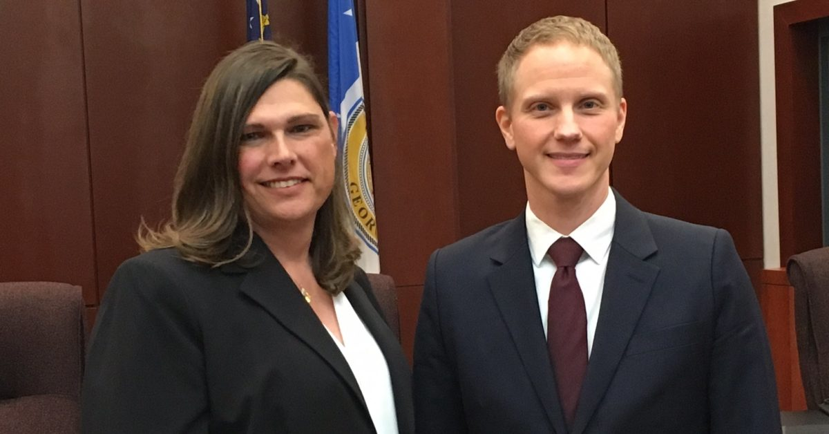 Transgender Houston County Sheriff's Sergeant Anna Lange and her attorney Noah Lewis pictured on February 19. (Avery Braxton WMAZ/Twitter)