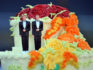 A wedding cake with statuettes of two men (GABRIEL BOUYS/AFP/Getty)