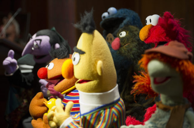 Bert and Ernie, who have long been rumoured to be gay, stand with 20 newly donated Jim Henson puppets and props on the anniversary of his birthday during an event at the Smithsonian National American History Museum in Washington, DC, on September 24, 2013