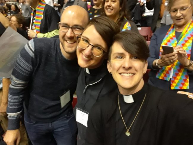 Delegates smile at the camera during the worldwide United Methodist General Conference in St. Louis, Missouri in 2019