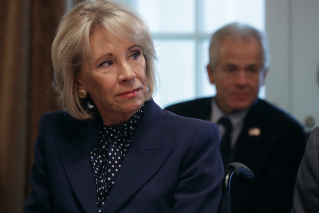 Education Secretary Betsy DeVos listens to U.S. President Donald Trump talk to reporters during a cabinet meeting in the Cabinet Room at the White House February 12, 2019 in Washington, DC.
