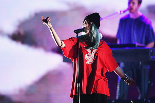 "Billie Eilish, who just released ""Wish You Were Gay,"" performs on stage during KROQ Absolut Almost Acoustic Christmas at The Forum on December 9, 2018 in Inglewood, California."