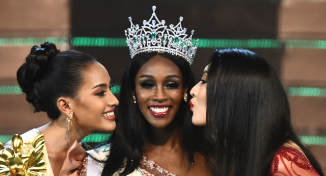 Jazell Barbie Royale (C) of the US, the Miss International Queen 2019 receives a kiss from finalists Kanwara Kaewjin (L) of Thailand and Yaya (R) of China during the transgender beauty pageant in Pattaya on March 8, 2019. (Jewel Samad/AFP/Getty Images)
