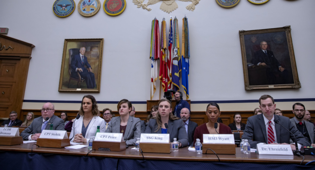 Navy Lt. Commander Blake Dremann, Army Capt. Alivia Stehlik, Army Capt. Jennifer Peace, Army Staff Sgt. Patricia King,  Navy Petty Officer 3rd Class Akira Wyatt, and Dr. Jesse M. Ehrenfeld, chair-elect of the American Medical Association Board of Trustees speak at the Military Personnel Subcommittee hearing on the transgender military ban. (Tasos Katopodis/Getty)