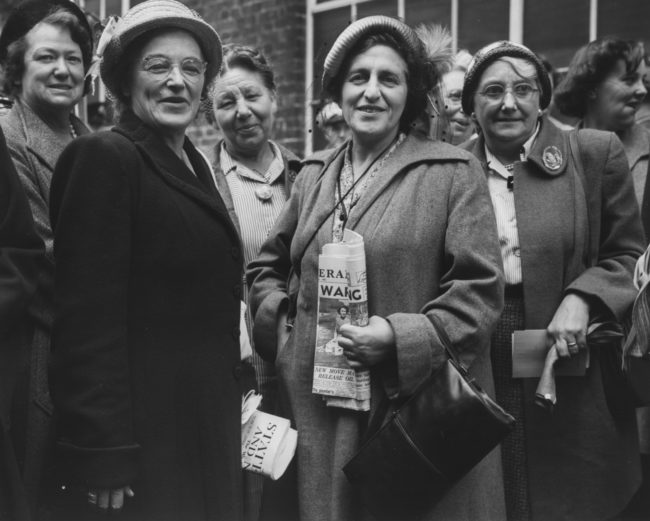 Dora Russell (left), former wife of social activist Earl Russell, and Mrs Sydney Silverman (centre), wife of Socialist MP for Nelson and Colne, are part of a delegation of women preparing to leave for a tour of Russia for International Women's Day, pictured at Kensington Air Station in London, August 10th 1951.