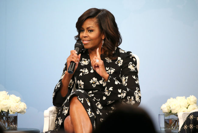 """Former First Lady of the United States Michelle Obama speaks during a panel discussion at Glamour Hosts """"A Brighter Future: A Global Conversation on Girls' Education"""" with First Lady Michelle Obama at The Newseum on October 11, 2016 in Washington, DC."""