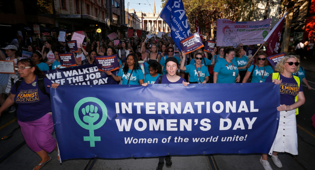 Thousands of demonstrators attend a rally for International Women's Day on March 8, 2017 in Melbourne, Australia.  Marchers were calling for de-colonisation of Australia, an end to racism, economic justice for all women and reproductive justice, as well as supporting the struggle for the liberation of all women around the world, inclusive of trans women and sex workers.  (Photo by Daniel Pockett/Getty Images)