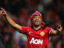 Patrice Evra of Manchester United celebrates victory and winning the Premier League title after the Barclays Premier League match between Manchester United and Aston Villa at Old Trafford on April 22, 2013 in Manchester, England.  (Alex Livesey/Getty)