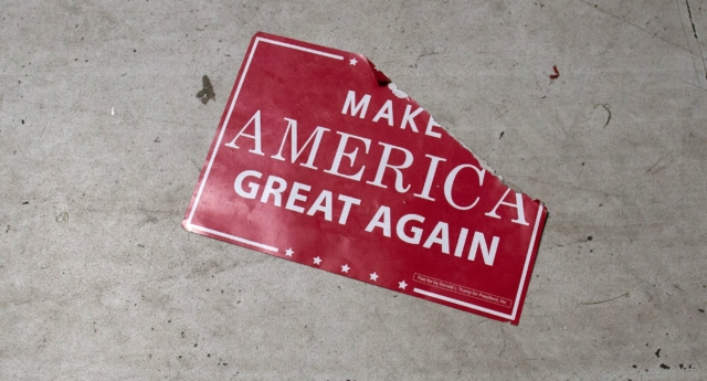 A 'Make America Great Again' sign sits on the floor following a Republican rally on October 24, 2018. (SAUL LOEB/AFP/Getty)