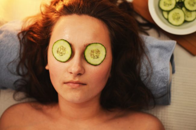 Mother's Day gift ideas: Spa treatment. Woman relaxing with cucumbers on eyes.