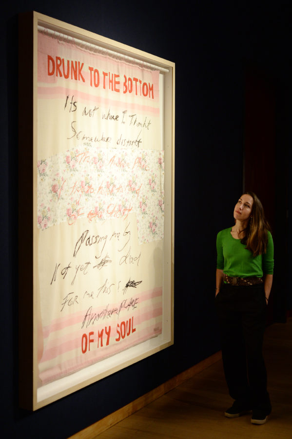 Staff member poses with work titled 'Drunk to the Bottom of my Soul' by Tracey Emin as Christie's presents an exhibition of works from it's George Michael Collection Highlights at Christie's on March 08, 2019 in London, England.