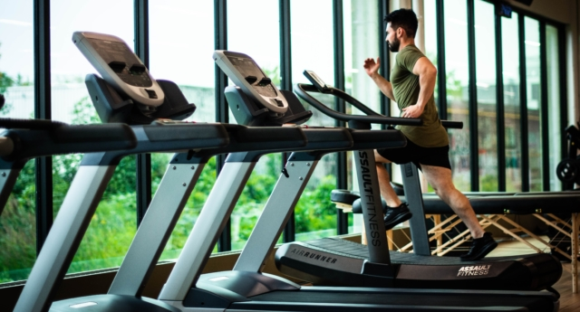 A man runs in a gym. (Stock photo)