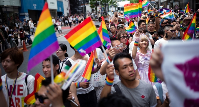 People attend the annual Tokyo Rainbow Parade in Tokyo, on May 6, 2018, to show support for members of the LGBT community. (Martin BUREAU / AFP