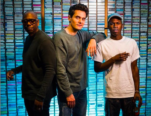 "Dave Chappelle (L) called Daniel Caesar (R) ""very gay"" during an appearance on John Mayer's (M) Instagram Live show."