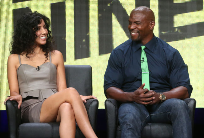 Actors Stephanie Beatriz (L) and Terry Crews speak onstage during the Brooklyn Nine-Nine panel discussion at the FOX portion of the 2013 Summer Television Critics Association tour - Day 9 at The Beverly Hilton Hotel on August 1, 2013 in Beverly Hills, California.