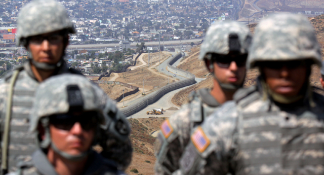National Guardsmen stand in formation along the U.S.-Mexico border during a visit by California Gov. Arnold Schwarzenegger August 18, 2010 in San Ysidro, California. (Sandy Huffaker/Getty Images)