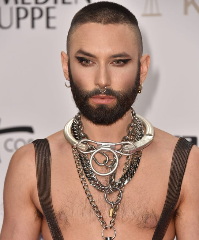 Austrian drag singer Conchita Wurst poses on the red carpet as he arrives at the Golden Camera awards ceremony in Berlin on March 30, 2019.