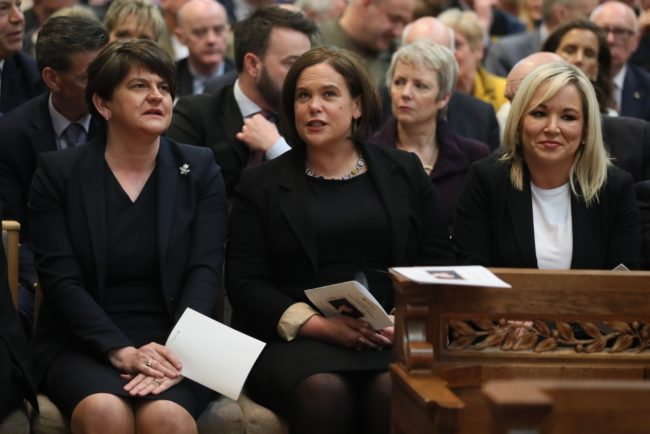 (L-R) Democratic Unionist Party (DUP) leader Arlene Foster, Irish Republican Sinn Fein party leader Mary Lou McDonald and Sinn Fein Northern Leader Michelle O'Neill attend the funeral service of journalist Lyra McKee, who was killed by a dissident republican paramilitary in Northern Ireland on April 18, at St Anne's Cathedral in Belfast on April 24, 2019.