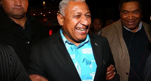 Frank Bainimarama speaks to Fiji First Party supporters as he leaves the Fiji Festival in 2014 (Simon Watts/Getty)