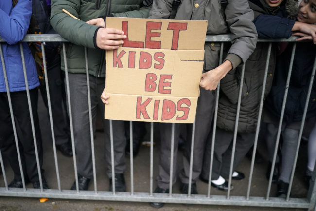 Parents and protestors demonstrate against the 'No Outsiders' programme, which teaches children about LGBT rights in Birmingham, England