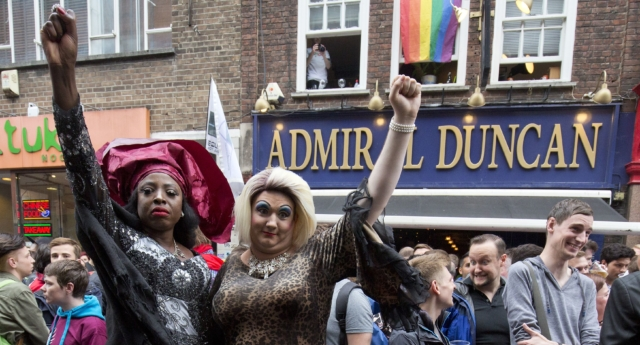People gathered outside the Admiral Duncan pub in Old Compton Street in the Soho, which was attacked with a nail bomb on April 30, 1999, to remember the victims of the Orlando massacre, on June 13, 2016. (Justin Tallis/AFP/Getty)