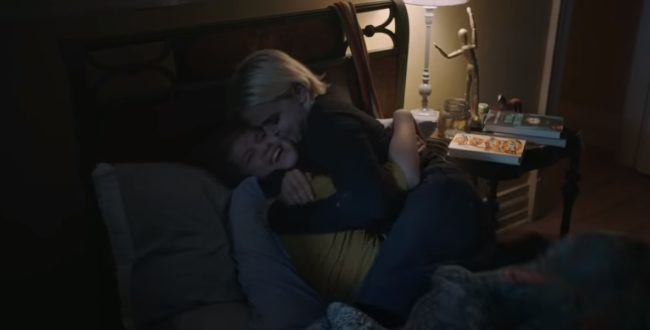 Good Girls character Annie, played by Mae Whitman, hugs son Sadie, played by Isaiah Stannard,