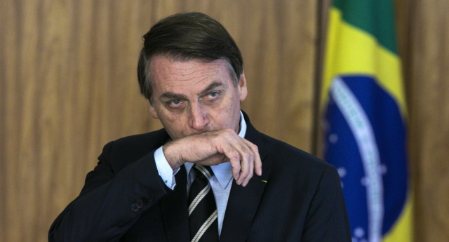 Brazilian President Jair Bolsonaro gestures during a ceremony of presentation of new diplomats' credentials at Planalto Palace in Brasilia, on March 8, 2019. (SERGIO LIMA/AFP/Getty)