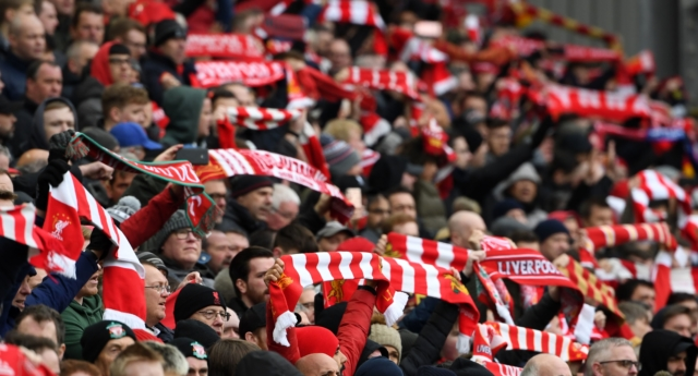 Liverpool supporters hold up their scarves in the crowd ahead of the English Premier League football match between Liverpool and Chelsea at Anfield in Liverpool, north west England on April 14, 2019. (Paul ELLIS/Getty)