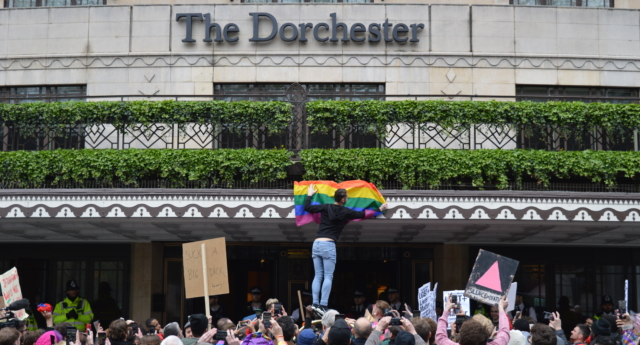 Protestors outside The Dorchester hotel in London. (Ella Braidwood)