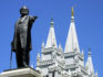A statue of Brigham Young, second president of the Church of Jesus Christ of Latter Day Saints stands in the center of Salt Lake City with the Mormon Temple spires in the background 19 July 2001. (GEORGE FREY/AFP/Getty)