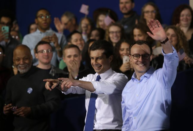 South Bend Mayor Pete Buttigieg acknowledges attendees with his husband Chasten Buttigieg after announcing his presidential candidacy for 2020 during an event on Sunday, April 14, 2019 in South Bend, Indiana.