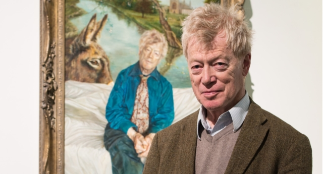 Sir Roger Scruton poses next to his portrait painted by Artist Lantian D at the Royal Society of Portrait Painters Photocall at the Mall Galleries on May 4, 2016 in London, England.  (Ian Gavan/Getty)