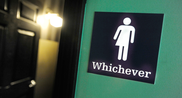 A gender neutral bathroom sign in the US. (D. Davis/Getty Images)
