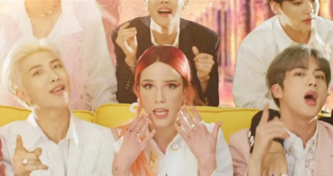 "Halsey looks to camera during the music video for ""Boys With Luv"" with BTS."